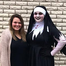 A customer dressed as a nun alongside a friend.